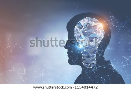 Side view of businessman silhouette with a glowing polygons light bulb and network holograms over a blurred background. Concept of a bright idea and creativity. Toned image double exposure mock up
