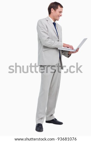 Side view of businessman working on his laptop against a white background