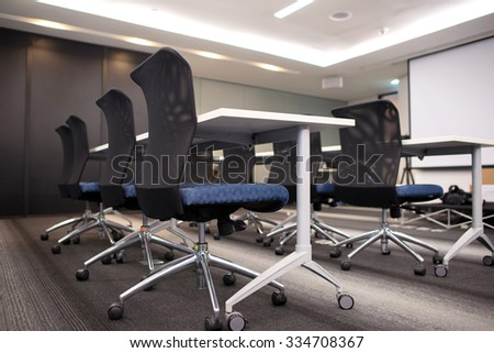Side view of chairs and tables prepared for seminar