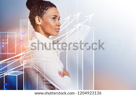 Side view of confident young african american businesswoman standing with crossed arms and looking forward. Immersive interface with growing bar chart. Toned image double exposure mock up #1204923136