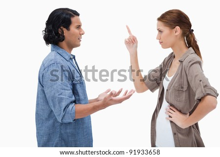 Side view of couple in a tensed conversation against a white background