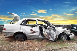 side view of crash car with blue sky