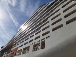 Side view of cruise ship on the blue sky background. Low angle view