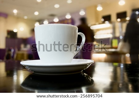 Side view of cup of coffee on broen table