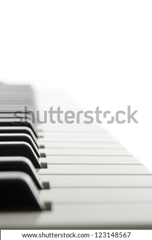 Side view of electronic piano keyboard keys.