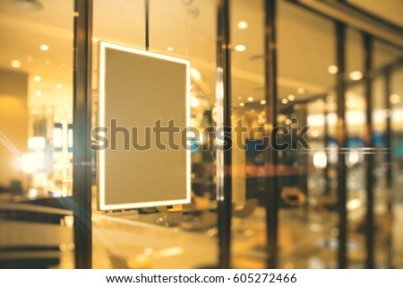 Side view of empty picture frame hanging on shop window. Ad concept