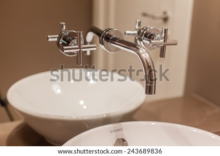 Side view of Faucet and marble sink in the luxury hotel