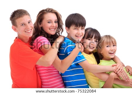 Side view of five happy young brothers and sisters in ascending age and height with colourful clothes; white background.