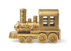 Side view of golden toy steam train locomotive isolated on white