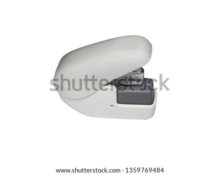 side view of gray staple-free stapler with paper clinch mini of office stationery  isolated on white background