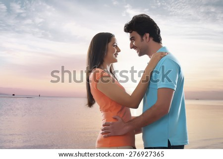 Side view of loving young couple embracing at beach