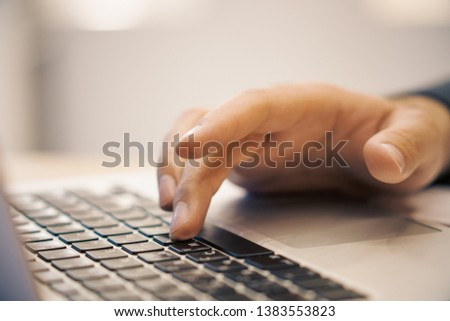 Side view of male hands using laptop keyboard on desk workplace. Blurry background. Education, communication, programming and software concept  #1383553823