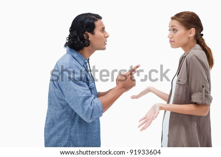 Side view of man asking his clueless girlfriend against a white background