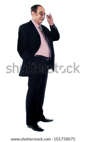 Side view of matured businessman holding his glasses isolated over white background
