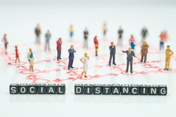Side view of miniature toys standing  - social distancing sentence concept.