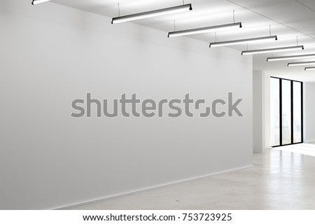 Side view of modern office interior with empty concrete wall, lamps and city view. Mock up, 3D Rendering