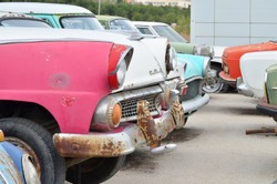 Side view of old cars. In red white blue tones