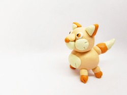 Side view of Plasticine statue  wolf character on a white background.
