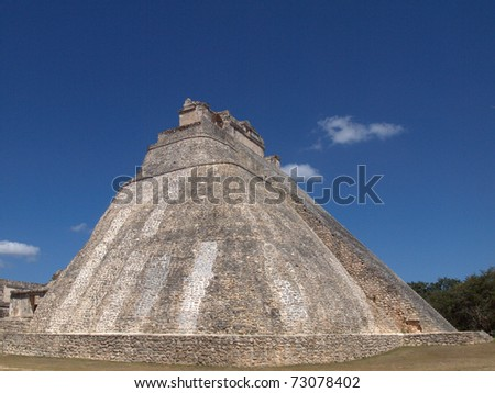 Side view of Pyramid of the Magician at Uxmal on Mexico's Yucatan Peninsula.  This restored round edifice was abandoned over 600 years ago, before the Spanish arrived in the area.