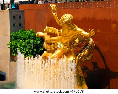 Side View of Rockefeller Center Statue and Fountain
