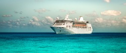 Side view of sailing cruise ship on Caribbean Sea.