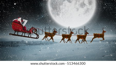 Stock Photo Side view of Santa Claus riding on sleigh during Christmas against balcony overlooking coastline at night