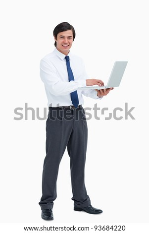 Side view of smiling tradesman with his laptop against a white background