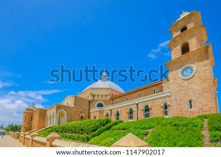 Side view of St. Francis Xavier's Cathedral with dome or Geraldton Cathedral on Cathedral Ave, is the main place of Catholic worship in Geraldton, Western Australia. Sunny with blue sky. Copy space.