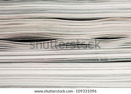 Side view of stack of papers, books, and magazines for recycling. close up