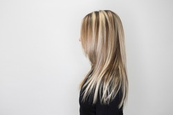 Side view of strait hair with highlights. Soft focus