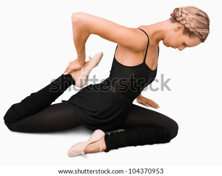 Side view of stretching woman against a white background
