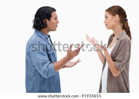 Side view of talking couple against a white background