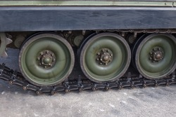 Side view of Tank tracks. A tank of the second world war.Close up view of world war tank road wheels