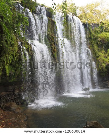 Side view of the idyllic  Llano de Cortes waterfall near Bagaces, Costa Rica - stock photo