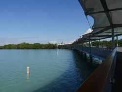 Side view of the shaded walkway at the floating dock of arvest Caye in Southern Belize.