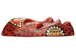 Side view of the wooden red mask from Thailand, decorated with black and white patterns, isolated on white background