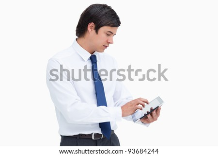 Side view of tradesman using tablet computer against a white background