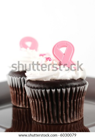side view of two cupcakes in support of breast cancer awareness