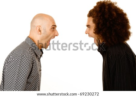 Side view of two young men, one with bald head and one with afro hairstyle, arguing. White studio background.