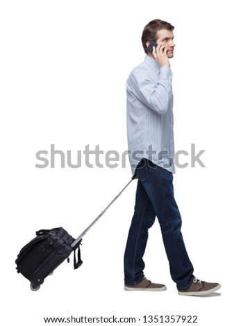 Side view of walking business man with suitcase talking on the phone. Standing young girl. Rear view people collection.   Isolated over white background. Young traveler rolls the suitcase and talking  #1351357922
