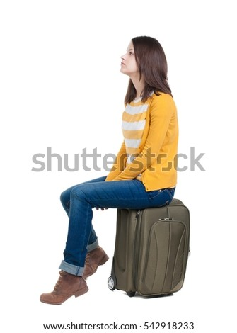 side view of walking  woman  in cardigan sits on a suitcase. beautiful  girl in motion.  backside view of person.  Rear view people collection. Isolated over white background. #542918233