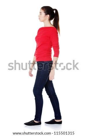 Side view of walking woman, isolated on white