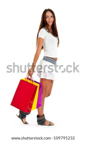 Side view of woman holding shopping bags against white backgroun