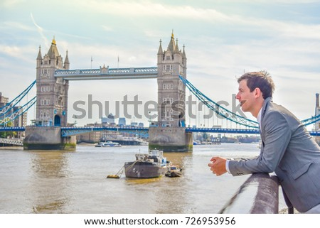 Side view of working Britian man is standing in front of Tower Bridge in England