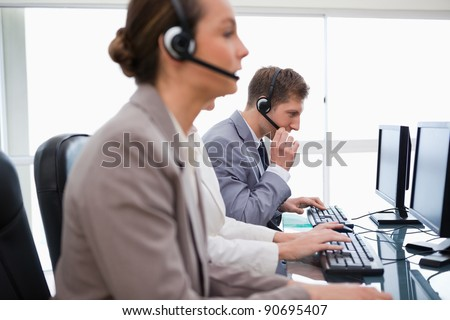 Side view of working call center agents