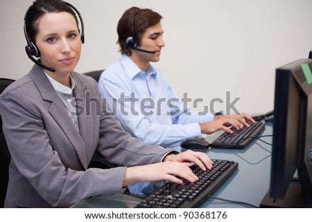 Side view of working young call center agents