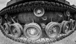 Side view of world war tank showing tracks, road wheels and drive sprockets black and white