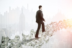 Side view of young businessman walking on abstract dollar banknote ladder on bright New York city background with copy space. Money concept. Double exposure