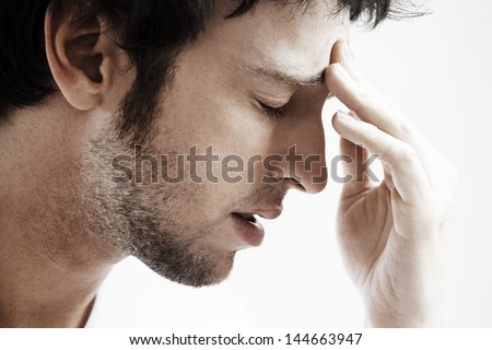 Side view of young man with headache touching forehead on white background #144663947