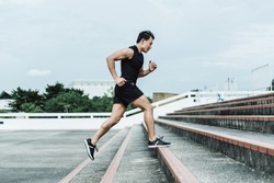 side view of young sport man running